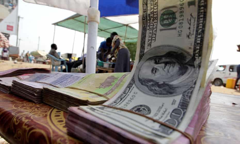 Banknotes are displayed on a roadside currency exchange stall along a street in Juba, south Sudan