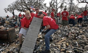 Emergency Response Team volunteers clean up debris from a home destroyed by Hurricane Katrina.