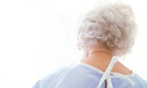 Elderly patient wearing a hospital robe.