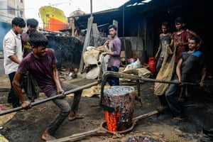 Dhaka, Bangladesh: Workers from all ages shipbuilding in what is known to be very dangerous working conditions with minimum safety guards, which often leads to accidents.