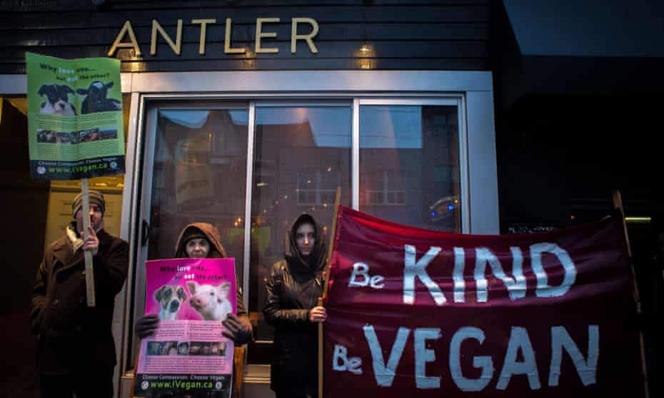 Vegan protesters gather outside of the Antler restaurant in Toronto on Saturday, March 31, 2018.