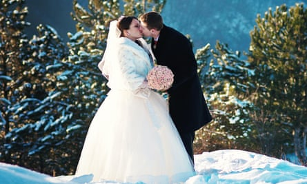 Young wedding couple at sunny winter day
