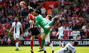 Palace goalkeeper Julian Speroni and Shane Long of Southampton compete for the ball during their Premier League match earlier this month.