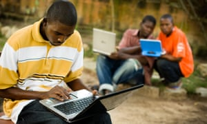 Students use laptops to browse the internet  Ghana