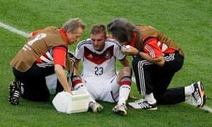 Germany's Christoph Kramer is treated by doctors in the World Cup final. He was allowed to play on, and subsequently admitted to having little memory of the game.