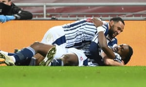 West Bromwich players celebrate after scoring.