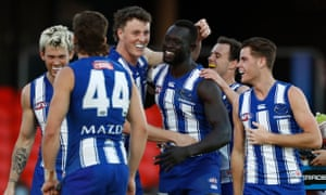 Majak Daw celebrates after scoring a goal during the match between North Melbourne and Adelaide