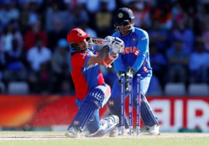 Afghanistan's Asghar Afghan is bowled out by India's Yuzvendra Chahal.