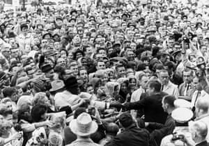 John F Kennedy greeting a large crowd at rally in Fort Worth, Texas on 22 November 1963