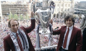 Aston Villa manager Tony Barton, left, and captain Dennis Mortimer celebrate with the European Cup in Birmingham after their victory in the 1982 Final.