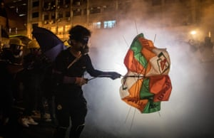 Protesters clash with police after taking part in an anti-extradition bill demonstration in Hong Kong.