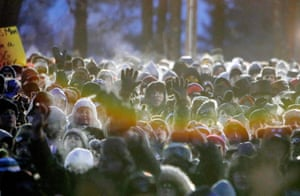 Steam rises from visitors' breath as they wait in the cold for Punxsutawney Phil's prediction