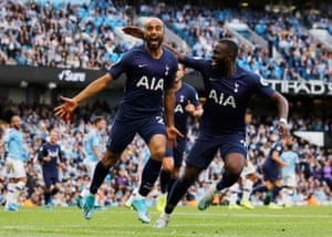 Moura celebrates scoring their second goal with Tanguy Ndombele.