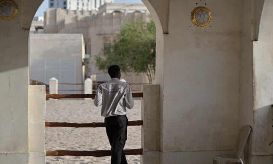 A security guard outside Souq Waqif, a marketplace in Doha, Qatar.