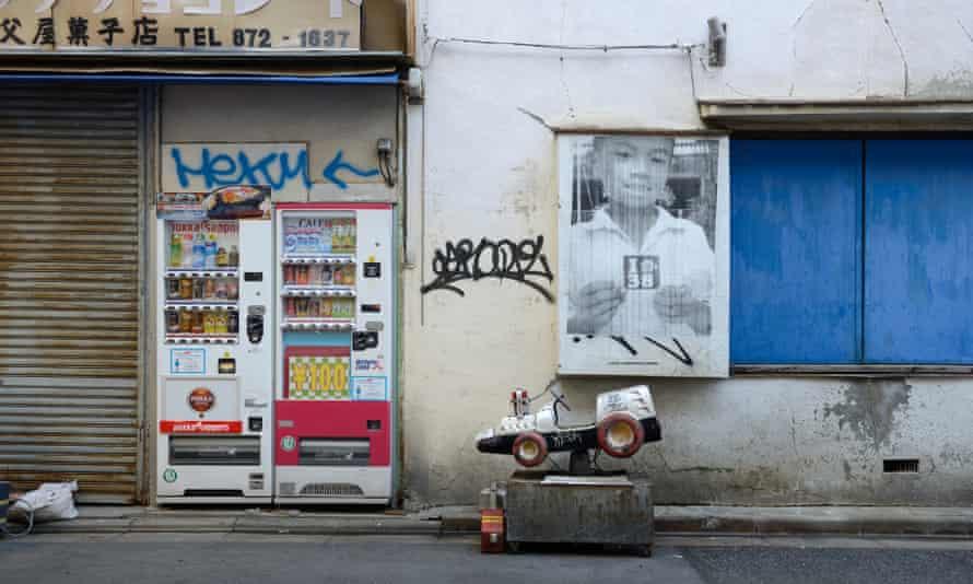 A shopfront and graffiti in Sanya.