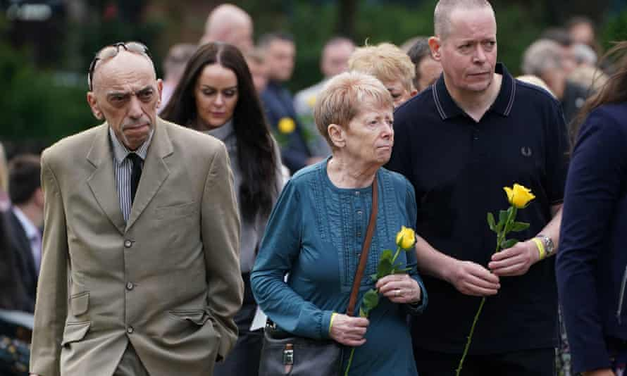 Family members of Dr David Wails at the memorial in Forbury Gardens, Reading.