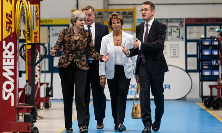 Theresa May at a coach building company in Guildford, August 2017
