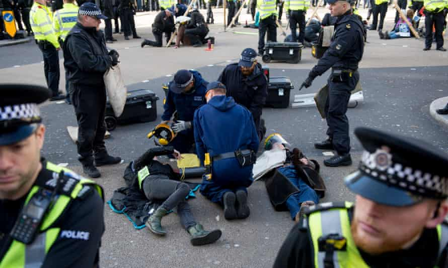 Police remove an Extinction Rebellion protester from Oxford Circus in central London
