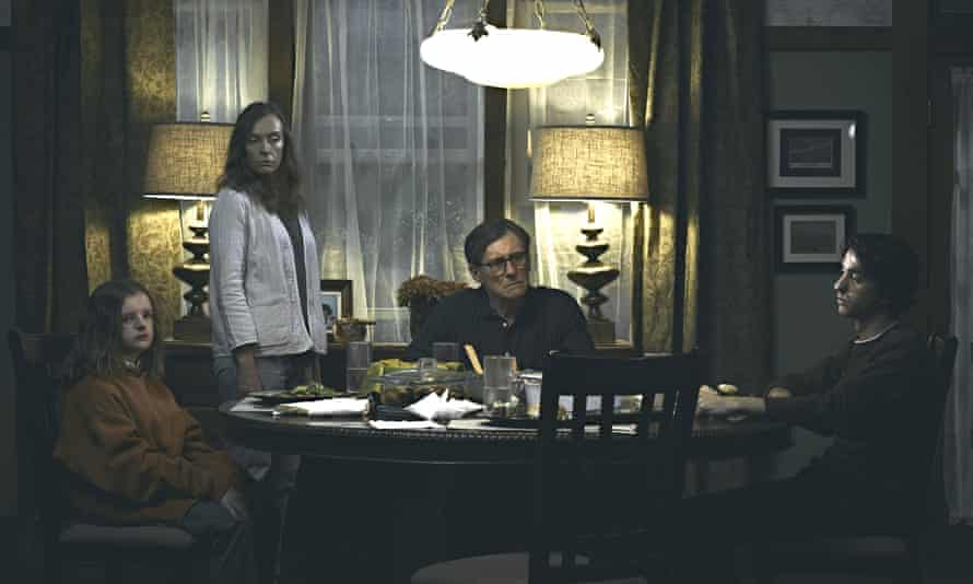 Toni Collette with Milly Shapiro, Gabriel Byrne and Alex Wolff in Hereditary.