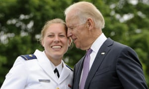Joe Biden poses for a photograph with newly commissioned US Coast Guard officer Erin Talbot in 2013.