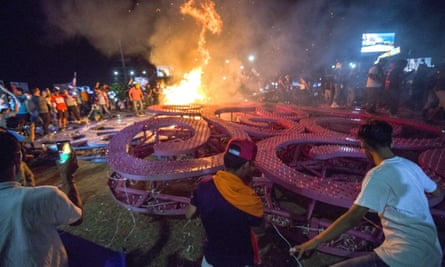 A 'Tree of life' is destroyed by protesters during the fourth consecutive day of demonstrations against social security reforms in Managua on 21 April.