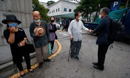 People gather outside the Seoul National University hospital