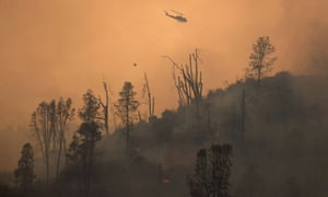 Helicopter releases water on a wildfire near Middletown, California on 24 August.