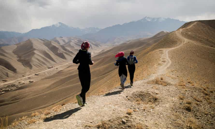Zainab, centre, is accompanied by two women – from Canada and Belgium – in Afghanistan's first official marathon.