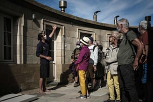 Dalisson shows visitors the lighthouse