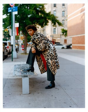 Coat, £2,590, by Versace. Trousers, £640, by Prada, from matchesfashion.com. Boots, £750, by Jimmy Choo
