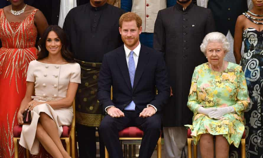 Meghan, Harry and the Queen at an event at Buckingham Palace in June 2018