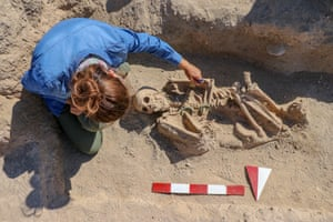 Van, Turkey An archaeologist works on the skeleton of a royal Urartu woman buried with jewelry at an excavation at a necropolis of the Urartu period in Gurpinar. The skeleton was found wearing pendulum earrings, a ring on her finger, a necklace on her neck, an ornamental pin, and dragon-headed bracelets on her both arms