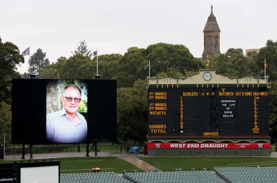Gavin Dallow's photo and name on the scoreboard during his funeral service at Adelaide Oval.