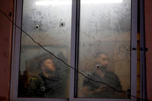 Nablus, West Bank. Bullet holes in the window of the headquarters of the Palestinian Authority's security services after an exchange of fire with Israeli troops.