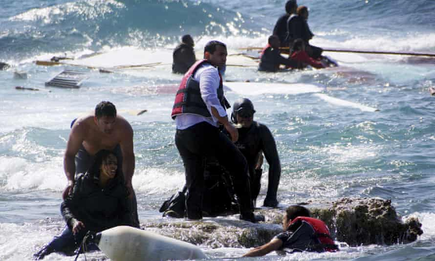 Migrants trying to reach Greece are rescued by members of the Greek coastguard and locals just off the island of Rhodes on 20 April.