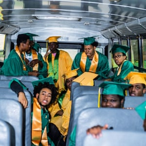Seniors from Northwestern High School ride the bus in their graduation gowns on their way to a local elementary school, a Flint tradition meant to inspire young students to stay in school. Northwestern is one of the last remaining high schools in Flint and will close at the end of the 2018 school year as a result of budget cuts and a shrinking population