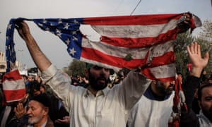 Iranian protesters deface US flags following the killing of Qassem Suleimani in Baghdad, Tehran, January 2020