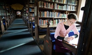 A student working in the library at Corpus Christi College at Oxford University