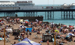 People enjoying the sunny weather at the beach in Brighton on Friday.