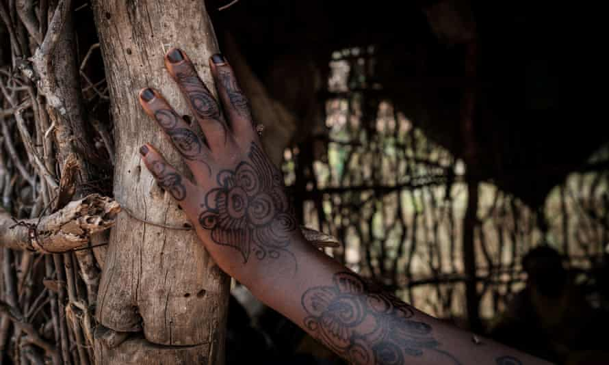 The henna decorated hand of a Somali girl