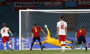 Gerard Moreno (centre) of Spain fails to score from the penalty spot.