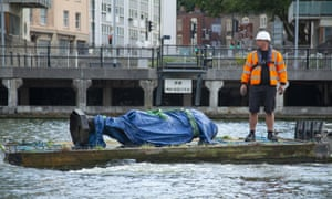 The statue of Edward Colston is recovered from the harbour in Bristol after it was toppled by anti-racism protesters on Sunday