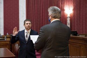 Derrick Evans is given the oath of office 14 December 2020, at the West Virginia state capitol.