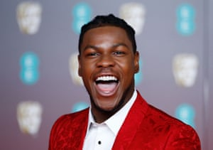 John Boyega looks unrecognisable from his turn as stormtrooper turned good guy in the Star Wars franchise. No desert-coloured survival style here. Instead, this brocade-style red suit is a bold choice and, with a lot of the men on the red carpet still playing it safe with black tuxes, one that we heartily approve of. No wonder he looks pleased with himself.