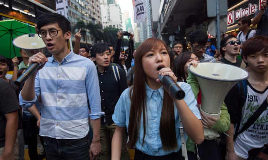 Baggio Leung, left, and Yau Wai-ching lead a protest against Beijing's changes to Hong Kong's constitution on 6 November.