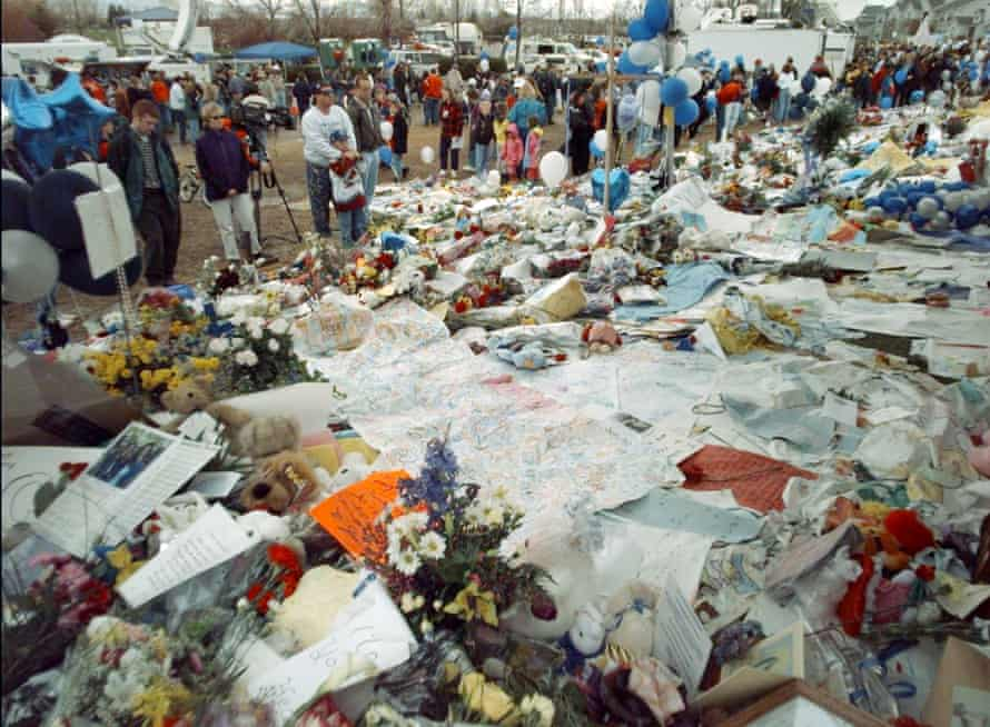 Flowers cover the ground after a memorial service for victims of the Columbine shooting