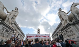 Protesters against the decline of the Italian capital hold a banner reading 'Rome says enough'.