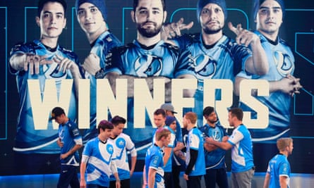 Luminosity shakes hands with Cloud9 after winning the match at the ELeague Arena at Turner Studios on 28 May in Atlanta, Georgia.