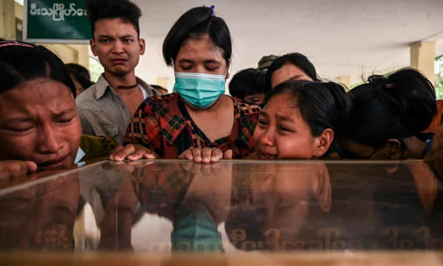 Relatives mourn over the dead body of Aung Ko Oo, who died on 29 March during a protest in Yangon, Myanmar amid a crackdown by security forces on demonstrations against the military coup.