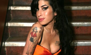 Amy Winehouse with the tattoo of her grandmother, Cynthia, designed by Henry Hate.
